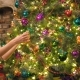 Young Woman Decorating the Christmas Tree - VideoHive Item for Sale