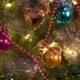 A Christmas Tree Decorated with Christmas Tree Toys and Shining Lights, . Christmas Tree Gold Bokeh - VideoHive Item for Sale