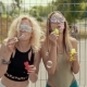 Beautiful Hipster Girls in Sunglasses Having Fun Making Bubbles Outdoors - VideoHive Item for Sale
