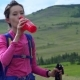 Woman Taking a Break To Drink From Water Bottle While Hiking. - VideoHive Item for Sale