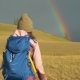 Woman Hiking. Hike in the Mountains. Woman Traveler with Backpack on Beautiful Summer Landscape - VideoHive Item for Sale