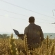 Farmer with a Laptop in the Field Checks the Quality of Wheat - VideoHive Item for Sale