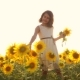Happy Little Girl on the Field of Sunflowers Sunlight in Summer - VideoHive Item for Sale