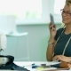 Girl Designer Talking By Phone While Working. - VideoHive Item for Sale