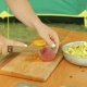 A Young Woman Cleanses a Peach From a Stone with a Knife - VideoHive Item for Sale