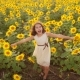 Happy Little Girl on the Field of Sunflowers in Summer. Beautiful Little Girl in Sunflowers - VideoHive Item for Sale