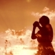 Woman Lifestyle Praying on Her Knees. Girl Folded Her Hands in Prayer Silhouette at Sunset - VideoHive Item for Sale