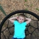 The Blue-eyed Five-year-old Boy in Blue T-shirt Lies on a Round Swing with His Hands Behind His Head - VideoHive Item for Sale