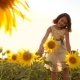 Cute Child Girl in Yellow Garden of Sunflowers Sunlight in Summer. Beautiful Sunset Little Girl - VideoHive Item for Sale