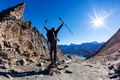 Hiker reaches a high mountain pass - PhotoDune Item for Sale