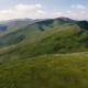 Aerial Shot of Beautiful Carpathian Ranges with Blurred Cloud Shades in Summer - VideoHive Item for Sale