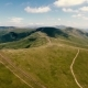 Aerial of Panoramic Carpathian Ranges Under Dark Cloud Shadows in Summer - VideoHive Item for Sale