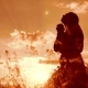 Girl Folded Her Hands in Prayer Silhouette at Sunset Woman Praying on Her Knees - VideoHive Item for Sale