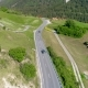 Aerial View of Cars and Bikes Traffic at Road in Mountains Above Valley . Fly Above Traffic on - VideoHive Item for Sale