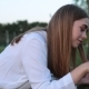 Young Woman with a Tablet Computer on the Grass - VideoHive Item for Sale