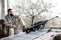 Elite squad sniper resting on city firing position - PhotoDune Item for Sale