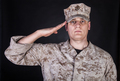 Portrait of marine saluting and looking at camera - PhotoDune Item for Sale