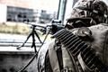 Commando soldier machine gunner firing from window - PhotoDune Item for Sale