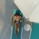 Aerial: Beautiful Girl Lies on a Lounger By the Pool and Drinking a Cocktail - VideoHive Item for Sale