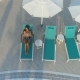 Aerial: Beautiful Girl Lies on a Sunbed By the Pool, Drinking a Cocktail - VideoHive Item for Sale