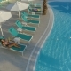 Beautiful Girl Lies on a Lounger By the Pool - VideoHive Item for Sale