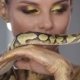 Woman with Body Art Holding Snake - VideoHive Item for Sale