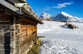 Wooden cabin in the snow with a view on the Dolomites - PhotoDune Item for Sale