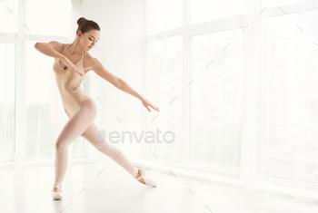 Ballerina in point shoes and dancing in studio