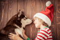 Happy child and dog on Christmas eve - PhotoDune Item for Sale