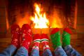 Family in Christmas socks near fireplace - PhotoDune Item for Sale