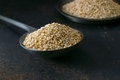 A metal spoon full of sesame seeds - PhotoDune Item for Sale