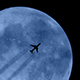 Plane Flies In Front Of Moon - VideoHive Item for Sale