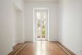 Empty, white room with large window in a renovated apartment - PhotoDune Item for Sale