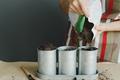 woman pour soil in metallic pot - PhotoDune Item for Sale