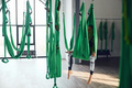 Aerial different inversion antigravity yoga with a hammock - PhotoDune Item for Sale