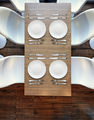 Top view from above on four empty plates on wooden table. - PhotoDune Item for Sale
