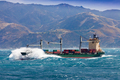 Loaded container freight ship in stormy sea - PhotoDune Item for Sale