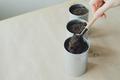 womans hand puts soil in metallic shovel into flowerpot - PhotoDune Item for Sale