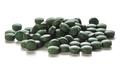 Spirulina Tablets Over White Background - PhotoDune Item for Sale