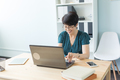 Business people and technology concept - Middle age woman is working at the office with laptop - PhotoDune Item for Sale