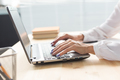 Business, technology and people concept - close up of woman's hands typing in laptop - PhotoDune Item for Sale