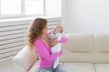 Childhood, motherhood, infant concept - happy mother holding her baby - PhotoDune Item for Sale