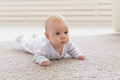 Child, childhood and infant concept - Pretty baby lie on the floor - PhotoDune Item for Sale