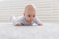 Baby, childhood, people concept - Portrait of a crawling baby on the floor - PhotoDune Item for Sale