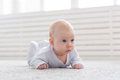 Childhood, babyhood and people concept - little baby boy or girl crawling on floor at home - PhotoDune Item for Sale