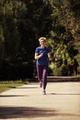 young female runner training for marathon - PhotoDune Item for Sale