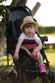 baby girl sitting in the baby stroller - PhotoDune Item for Sale