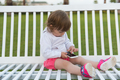 little girl playing with mobile phone - PhotoDune Item for Sale