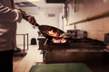 Chef doing flambe on food - PhotoDune Item for Sale