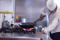 chef preparing food, frying in wok pan - PhotoDune Item for Sale